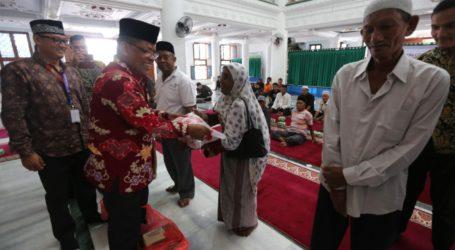Pemkot Banda Aceh dan Bank Muammalat Serahkan Zakat Bagi Kaum Duafa
